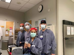 residents in masks and scrubs