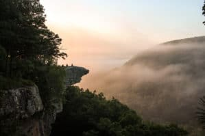 Image of Hawksbill Crag over a foggy valley