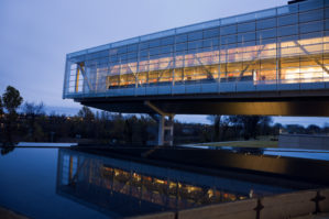 Exterior of William J Clinton Presidential Center in Little Rock at night.
