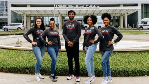 Anesthesia tech students pose outside the UAMS Medical Center with Veronica Ussery, education director.