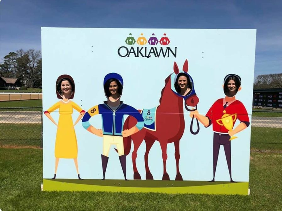 residents posing in a jockey sign at Oaklawn race track