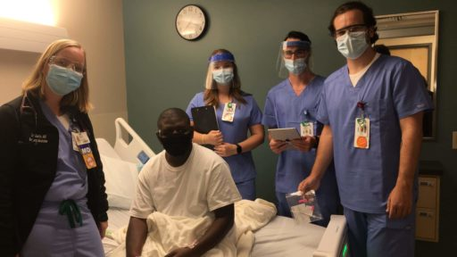 Dr. Eastin and students at a patient's bedside