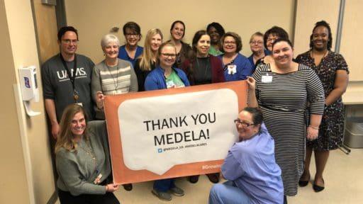 Group holding Medela Sign