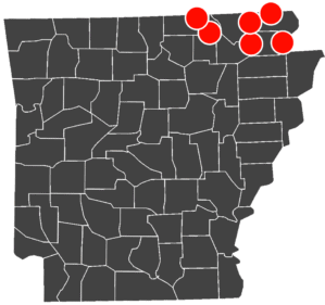 Arkansas map showing counties with red dots designating the location of clinics.