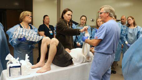 Dr. Frazier shows a class of physicians how to splint an arm.