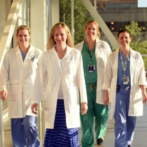 Residents walking in a medical environment