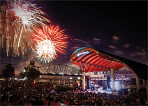 Rivermarket ampitheater in Little Rock with crowd and fireworks