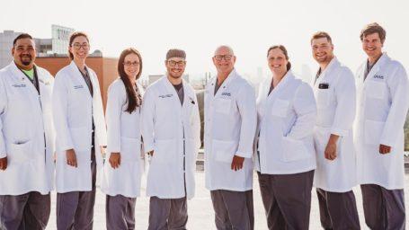 Trauma faculty posing on helipad