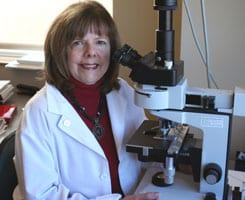 Dr. Childs with a microscope