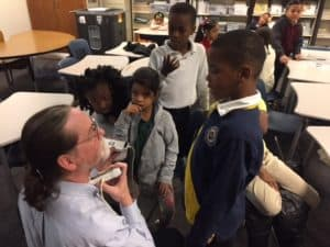 Dr. Phelan showing ultrasound unit to elementary students