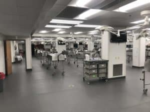Interior of the gross anatomy lab, showing tables, lights, and computer monitors