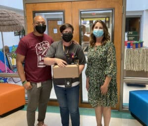 Three teachers holding boxes of infrared imaging devices