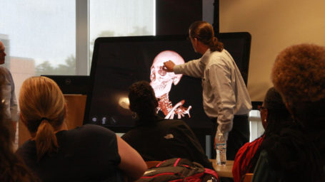 Dr. Phelan demonstrates the Sectra table in front of a group