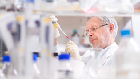 Scientist researching in laboratory.
