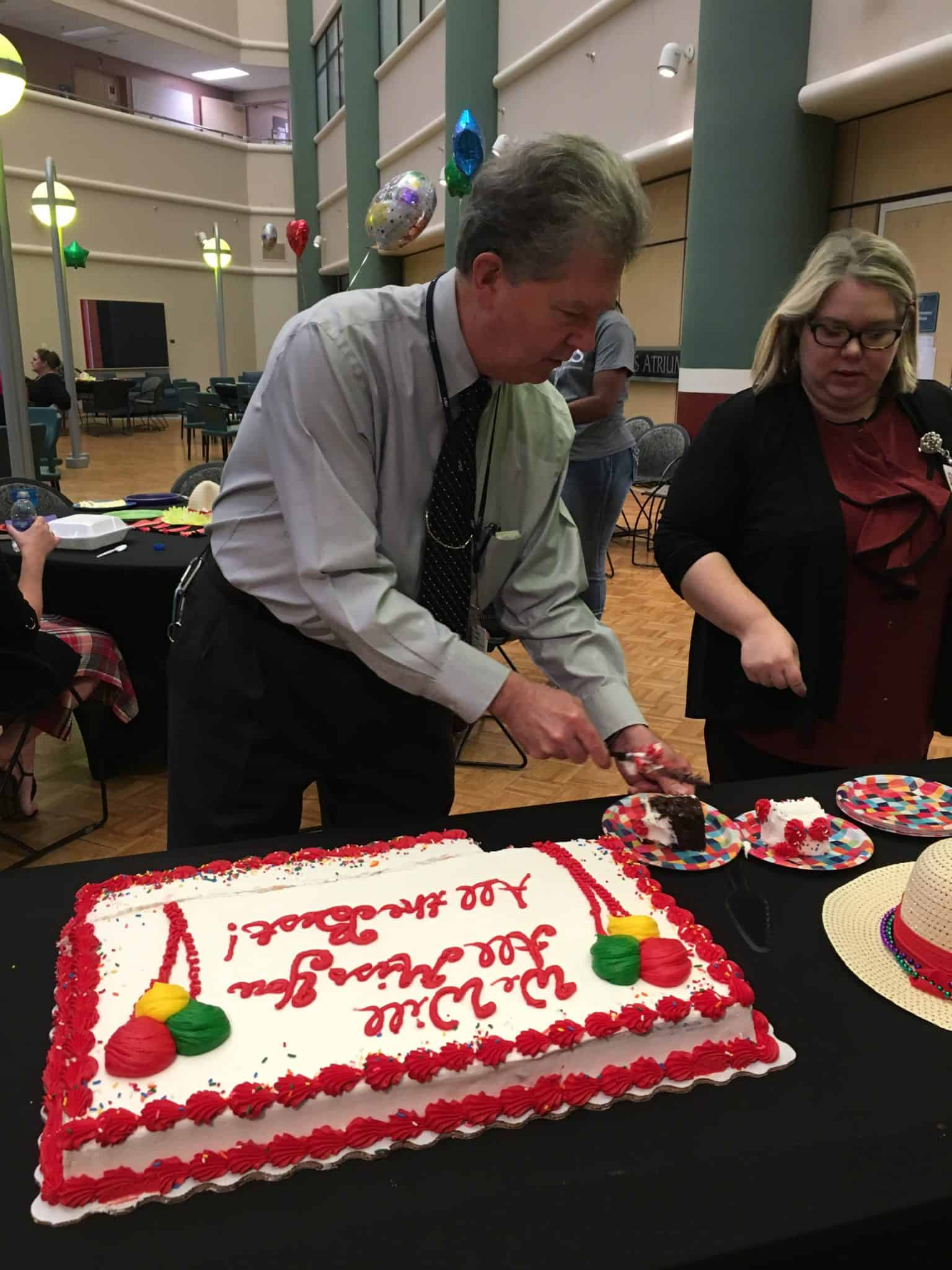 Rod Romily cuts his retirement cake