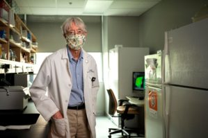 Dr. Brian Storrie posing in a research lab