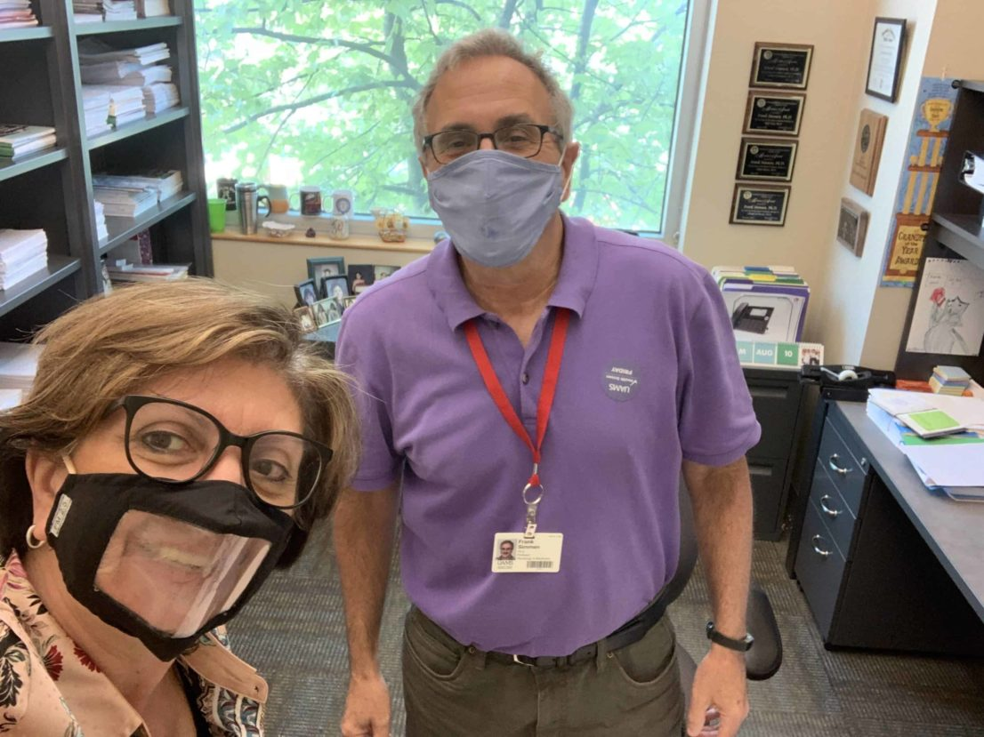 Dr. Bellido with Dr. Frank Simmen, wearing masks