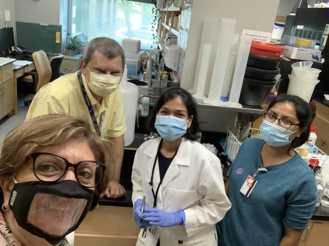 Dr. Bellido in the Lupashin Lab, everyone wearing masks
