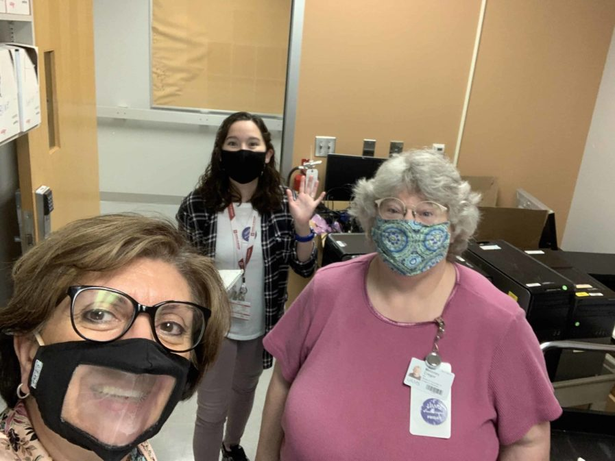 Dr. Bellido with her masked lab staff