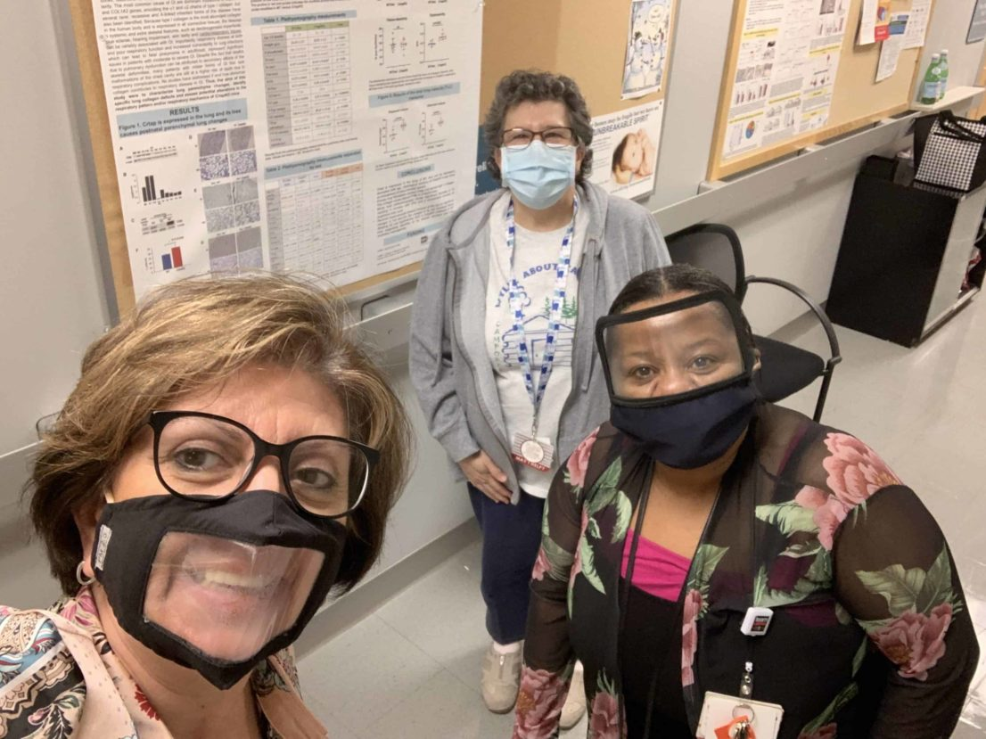 Dr. Bellido with masked staff members in the hallway