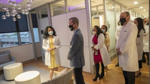 People standing in a waiting room at the new UAMS breast center