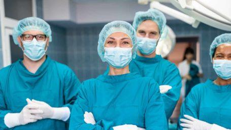 Group of surgeons looking at camera