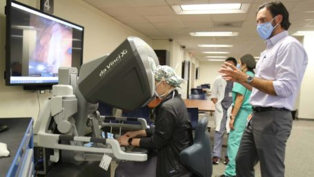 Dr. Mustain instructs resident on the Da Vinci robotic system