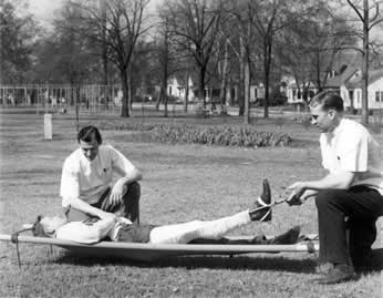 Medical students with patient outside