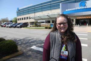 Carly Roark, M.D. in front of Arkansas Children's Hospital