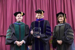 Award presentation to Dr. Kristie Hadden
