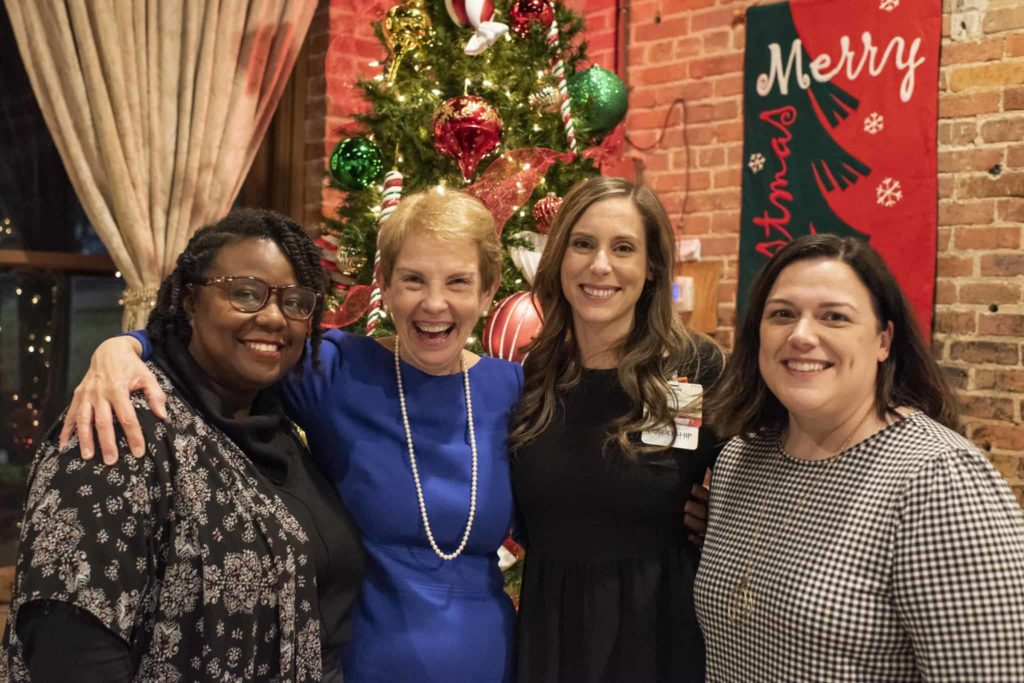 Group of faculty members posing at a holiday party