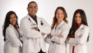 Four medical students wearing white coats