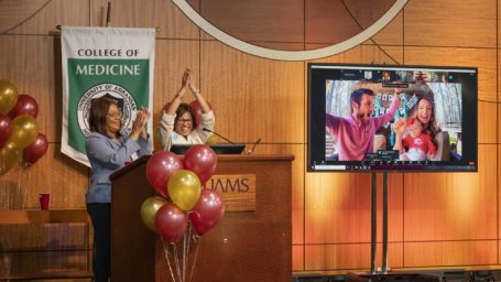 Faculty celebrates with students on a monitor during Match Day 2021
